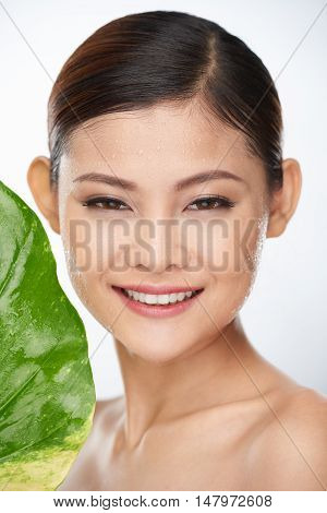 Vietnamese young woman using deep hydration treatment for her face