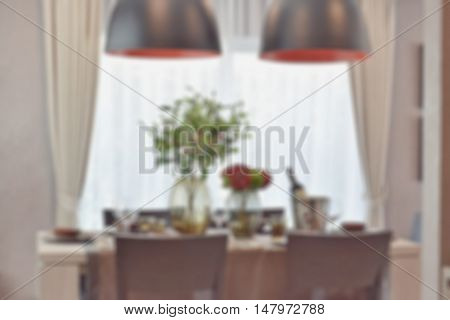 Blur Image Of Modern Classic Dining Set In Luxury Dining Room