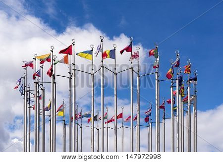 Nationals flags of countries on the blue sky