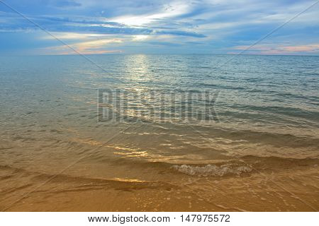 Sunrise and beach. Morning at sea beautiful Sky colorful water with reflection. ( Cold Warm Filter) : copy space for add text above