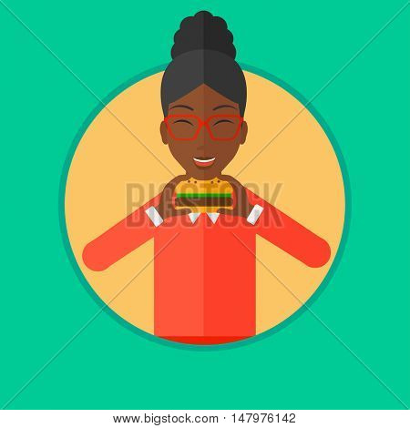 An african-american woman eating hamburger. Woman with eyes closed craving hamburger. Woman is about to eat delicious hamburger. Vector flat design illustration in the circle isolated on background.