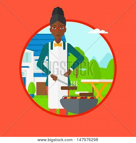 An african-american woman cooking meat on the barbecue grill in the backyard. Young woman preparing food on the barbecue grill. Vector flat design illustration in the circle isolated on background.