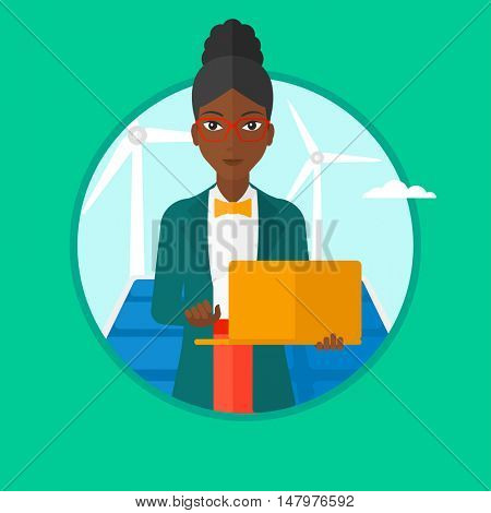 An african-american worker of solar power plant and wind farm working on laptop on a background of solar panels and wind turbines. Vector flat design illustration in the circle isolated on background.