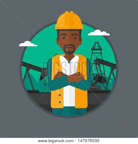 An african-american oil worker in uniform and helmet. An oil worker with crossed arms. Man standing on a background of pump jack. Vector flat design illustration in the circle isolated on background.