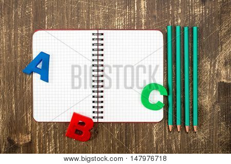 Blank personal organizer with pencils and ABC letters