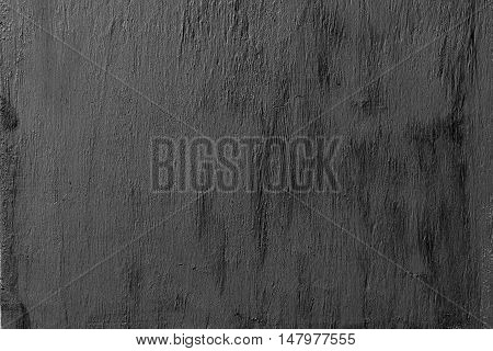 Abstract black background with rough distressed aged texture wood
