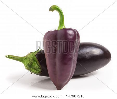 eggplant and purple bell peppers isolated on white background.