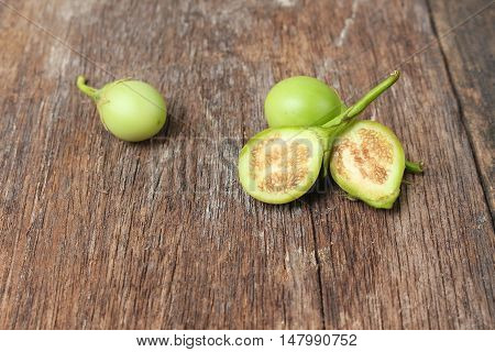 eggplant cut  slices fresh organic green  vegetable on a wooden background.(Solanum melongena Solanum virginianum L.) :  and copy space.