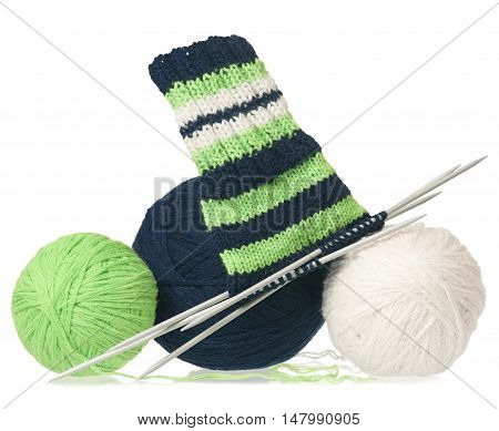 Woolen thread with incomplete socks isolated on white background