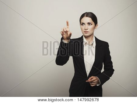 Businesswoman Pressing Button Or Something Iisolated With Copy Space For Your Design.