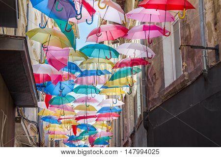 Umbrellas in a street of Avignon, France