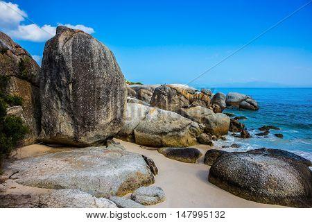 Huge boulders on the ocean shore. Travel to South Africa, the Atlantic Ocean