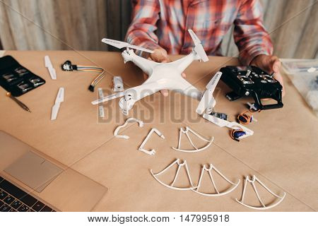 Assembled drone in male hands, diy aero model. Ready for use quadrocopter with some elements of it. Modern technologies, innovation, hobby, aeromodelling concept