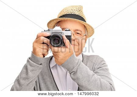 Mature man taking a picture with a camera isolated on white background