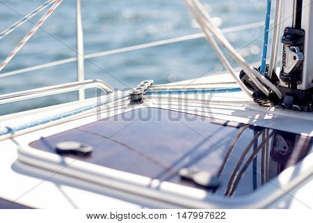 vacation, travel, cruise and yachting concept - close up of sailboat or yacht hatch sailing in sea