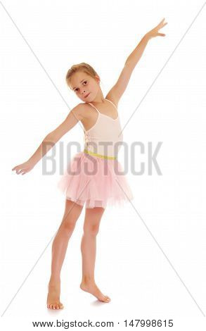 Charming little girl ballerina in a pink translucent dress.Isolated on white.
