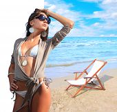 stock photo of idealistic  - Beautiful woman with idealistic beach landscape   - JPG