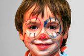 stock photo of face painting  - closeup of a boy with painted face - JPG