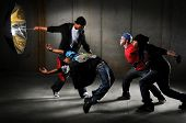 stock photo of break-dancing  - Hip hop men performing and act over an urban background - JPG