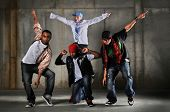 Hip hop men dancing over a grunge background