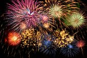 stock photo of firework display  - Colorful fireworks of various colors over night sky - JPG