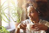 People And Leisure. African Woman Dressed In Trendy Clothes Holding Cup Of Coffee Or Tea, Enjoying H poster