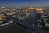 Постер, плакат: Big Stone Bridge Moskva river Kremlin with illumination in Moscow Russia view from Stalin skyscr