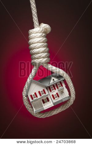 House Tied Up and Hanging in Hangman's Noose on Red Spot Lit Background.