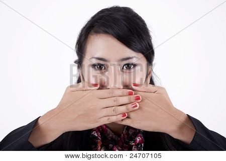 Asian Businesswoman With Fingers On Lips