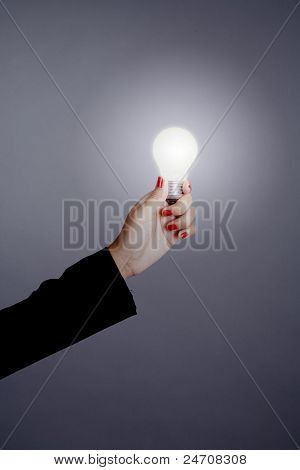 Woman Hand Holding A Light Bulb