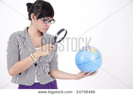 Beautiful Woman With Magnifying Glass  Searching The Earth