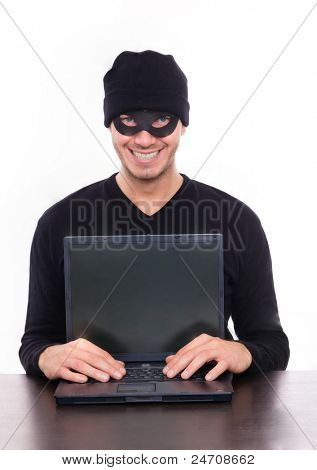 smiling hacker stealing data