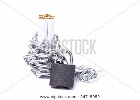 Pile Of Cigarettes And A Padlock With Chain