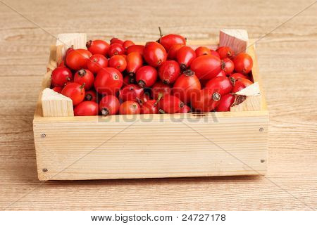 ripe briar in wooden box on wooden table on wooden background