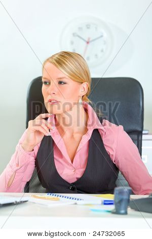 Thoughtful Modern Business Woman Sitting At Office Desk