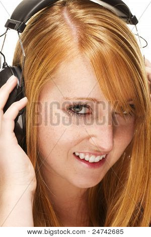 young redhead woman listening to music