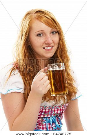 pretty bavarian girl with a glass of beer