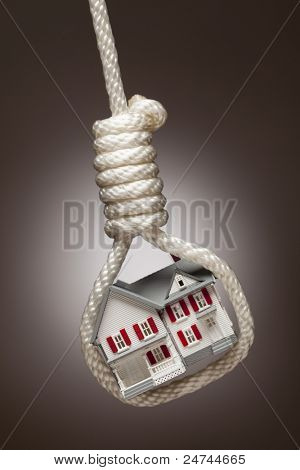 House Tied Up and Hanging in Hangman's Noose on Spot Lit Background.