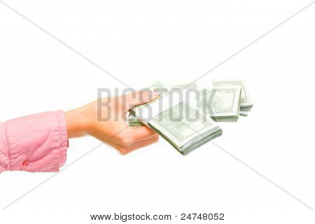 Female Hand Holding Packs Of Dollars