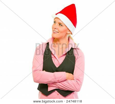 Portrait Of Smiling Modern Business Woman In Santa Hat Looking In Corner