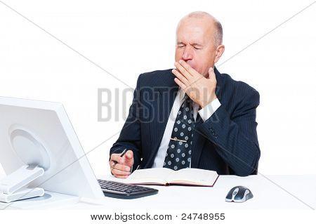 tired senior businessman in office over white background