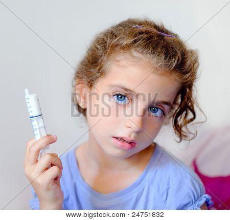 almost happy children kid girl with syringe of antibiotic medicine
