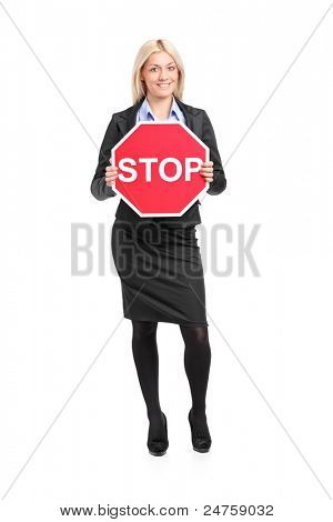 Full length portrait of a businesswoman holding a traffic sign stop isolated on white background