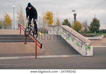 Biker Doing Crank Slide Grind Trick