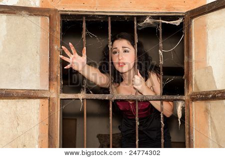 Desperate woman behind bars asking for help