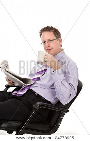 Happy Looking Businessman Reading Newspaper Drinking Coffee on Isolated White Background