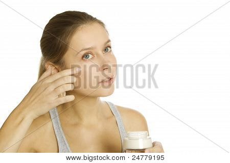 Beautiful girl holding cream