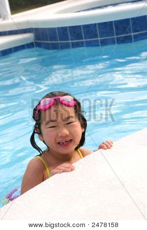 Little Girl Smile At Outdoor Pool