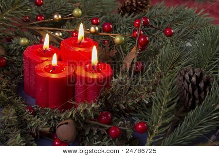 red advent candles and berries