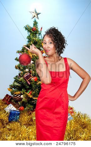 Black Woman Holding A Christmas Ornament